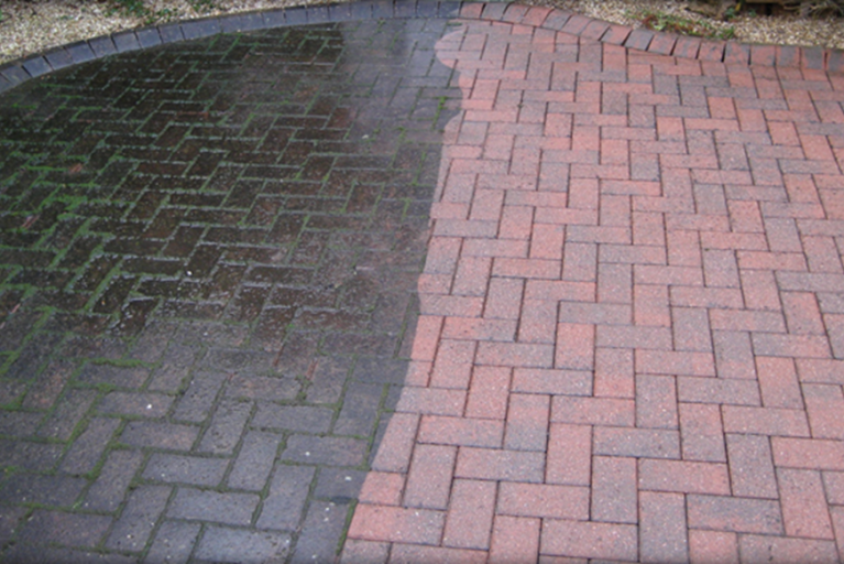 Driveway cleaning before and after.